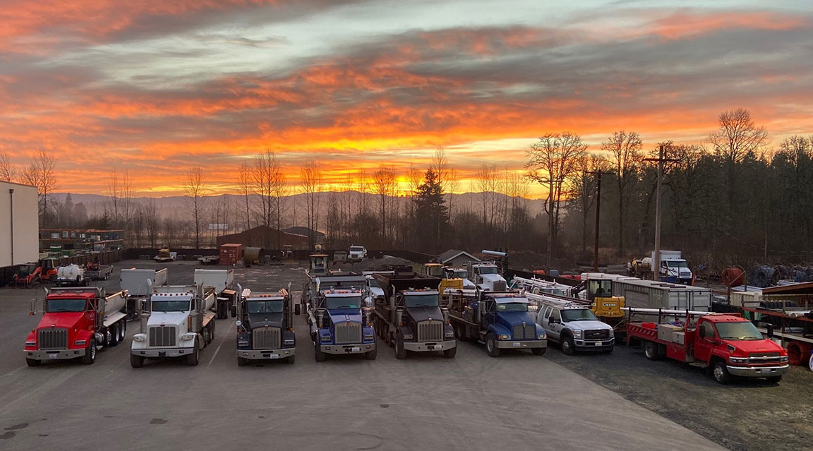 Tapani Excavation work trucks at sunset